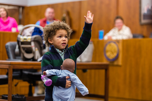 """Xavier Ahlbrand, 3, raises his """"other right hand,"""" swearing that he'll keep his baby doll safe in front of Judge Vicki Carmichael at the Clark County Government Building on Saturday. Staff Photo By Josh Hicks"""
