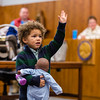 "Xavier Ahlbrand, 3, raises his ""other right hand,"" swearing that he'll keep his baby doll safe in front of Judge Vicki Carmichael at the Clark County Government Building on Saturday. Staff Photo By Josh Hicks"