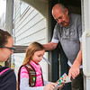 Jade, 9, takes down a Girl Scout Cookie order from Gary French in Clarksville on Wednesday. Staff Photo By Josh Hicks