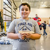 "Jonathan Howlett, 9, holds up ""Tron,"" a soon-to-be pink and black Pinewood Derby race car, at the Clarksville Fire Department on Saturday. Staff Photo By Josh Hicks"