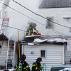 A house caught fire on the 1700 Block of East Elm Street in New Albany on Saturday. Staff Photo By Josh Hicks