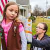 Jade's mother Casey Lemarr, right, fills in a few details on a Girl Scout Cookie order form in Clarksville on Wednesday. Staff Photo By Josh Hicks