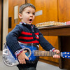 "Junior Johnny Cash impersonator Wyatt Pickerrell, 2, performs ""Baa Baa Black Sheep"" after adopting his guitar and drum sticks at the Clark County Government Building on Saturday. Staff Photo By Josh Hicks"