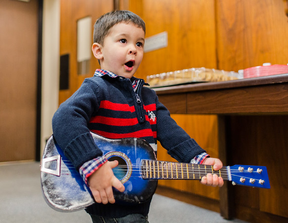 """Junior Johnny Cash impersonator Wyatt Pickerrell, 2, performs """"Baa Baa Black Sheep"""" after adopting his guitar and drum sticks at the Clark County Government Building on Saturday. Staff Photo By Josh Hicks"""
