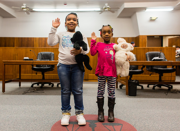 Sisters Jordyn, 8, left, and Jayden, 5, speak in unision, agreeing before Judge Vicki Carmichael that their two stuffed loved ones are in good hands at the Clark County Government Building on Saturday. Staff Photo By Josh Hicks
