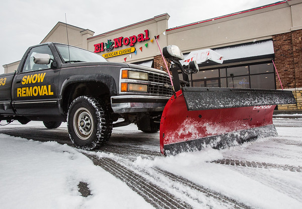 Jake Harbin takes the wheel, plowing a fresh layer of snow off of a Jeffersonville Parking lot on Thursday. Staff Photo By Josh Hicks
