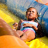 Braelyn Leavell, 7, water splashes across her face during Summer Explorers at Gateway Park on Wednesday.
