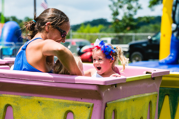 Micha, 4, screams while on a ride with her little brother, JD, 2, and mother Erika during Pekin's 187th celebration of the Fourth of July at Pekin Park on Saturday. Staff Photos By Josh Hicks