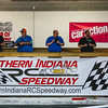 Radio controlled race car drivers follow and pilot their remotely from a stand at Southern Indiana RC Speedway in Clarksville on Saturday. Several groups competed in the speedway's Scale Reproductions Independence Day On-road Bash. Staff Photos By Josh Hicks