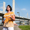 RiverLink spokesperson Mindy Peterson discusses the second quarter tolling numbers on the three bridges that connect Louisville and Southern Indiana during a press conference on Tuesday. Staff Photo By Josh Hicks