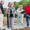 Charlestown Mayor Bob Hall, left, accompanies Violet Pelsor, flings a shovel of dirt into the air alongside her friend Jeanetta Jackson during the ground breaking of Springville Manor on Thursday. Pelsor and Jackson have both lived in Pleasant Ridge for years and will be living in Springville Manor upon its completion. Staff Photos By Josh Hicks