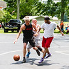 Anthony Adkins chases a loose ball during the men's open championship at Pekin's Fourth of July celebration. His team, Team Hensley took home the first place trophy.