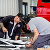 Jason Casey, left, and Scott Sprowles assemble a ladder rack together at Knapheide Truck Equipment Center in Jeffersonville on Friday. Staff Photos By Josh Hicks