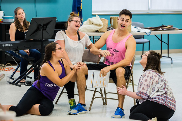 Three girls fawn over Brian Bowels as Gaston during their Beauty and the Beast rehearsal at the Ken Ellis Center in Jeffersonville on Saturday.