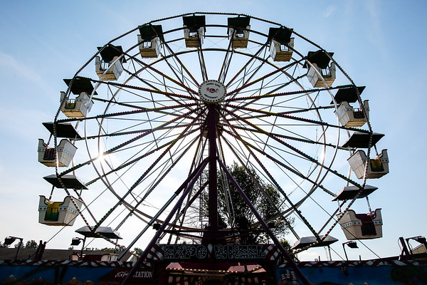 The harsh sun rises behind the feris wheel at the Clark County 4-H Fairgrounds on Thursday. The Fair officially opens Friday. Staff Photos By Josh Hicks