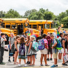 Teachers line up students at Johnathon Jennings Elementary in order to make sure they get on the right bus after their first day of school on Thursday. Staff Photo By Josh Hicks