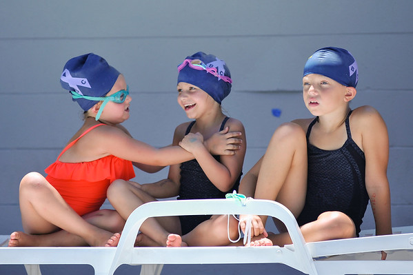 West Clark Swim Team's Bella Schindler, left, Baileigh Blankenbaker, center, and Allison Schuck await the start of their 100-meter freestyle races during the Southern Indiana Swim Association championship meet hosted by West Clark Swim team in Sellersburg on Saturday.  Photo by Joe Ullrich