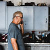 Sam, 65, drops what he's doing to take a phone call at his shop in Jeffersonville.