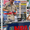 Greg Sullivan, who has been an NRA member for five years, mans the association's booth at Pekin's Fourth of July Celebration.