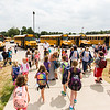 Second through Fifth graders from Silver Creek Elementary School walk out to their busses after the first day of school on Wednesday.