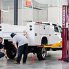 Knapheide Truck Equipment Center employees lower a new truck body onto a frame in Jeffersonville on Friday. Staff Photos By Josh Hicks