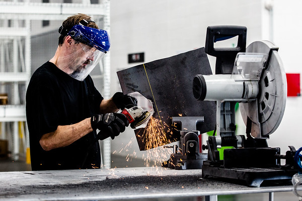 Rob Haley fabricates a part with a grinder while working at Knapheide Truck Equipment Center in Jeffersonville on Friday. Staff Photos By Josh Hicks