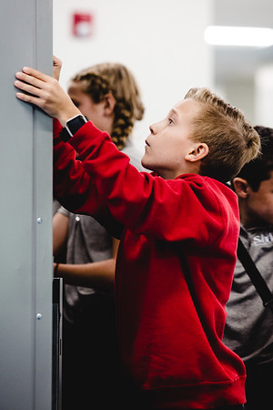 St. Mary of the Knobs sixth grader Cade Unruh, 11, dials in the combination to his locker during his first day of middle school.