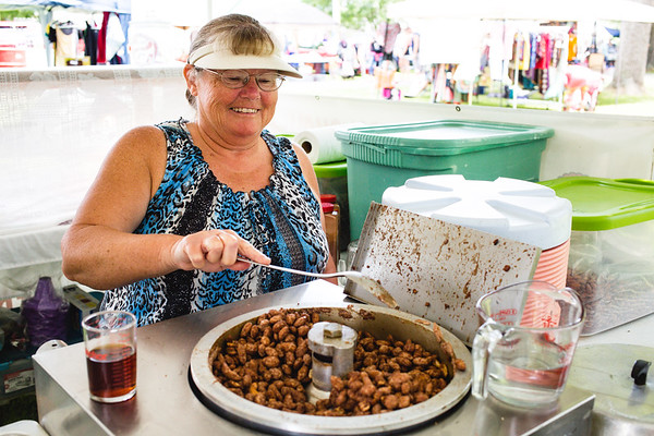 Caroly Myers came in from Austin, Indiana to whip up batches of roasted nuts during Pekin's Fourth of July celebration at Pekin Park on Saturday.