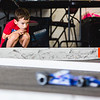 Braden Branham, 5, watches intently as cars pass him at Southern Indiana RC Speedway on Saturday.