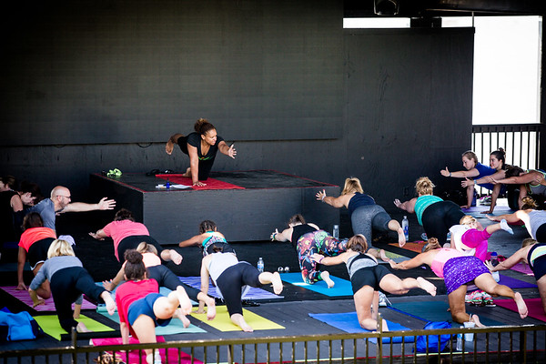 Around 40 people gather around Jennifer Evans, an instructor from Inner Spring Yoga for some morning exercise on Saturday.