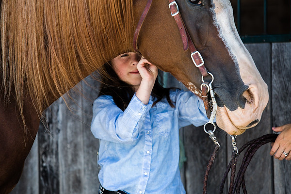 Hanalyn Goemmer, 9, secures a strap on her rescue horse Bint. She has been riding for 3 years.