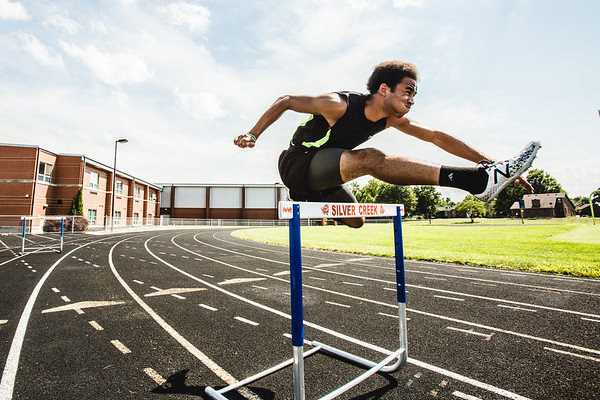 Tremaine Gonzales hurdles at the Silver Creek track on Monday.