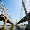 The I-65 Kennedy Bridge, left, and Abraham Lincoln Bridge, reach into Southern Indiana from Louisville. Staff Photo By Josh Hicks