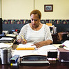 Principal Virenda Cunningham-Lester fills out some paperwork at her desk at Spring Hill Elementary. Staff Photo By Josh Hicks