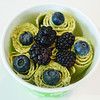 Fresh blueberries and blackberries sit atop green tea flavored ice cream rolls from Zero Degrees Thai Ice Cream.
