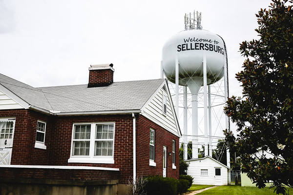 The Sellersburg water tower peaks out from behind a residence. Staff Photo By Josh Hicks