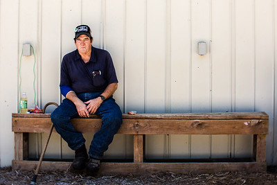 John Neofes has been involved with the dairy barn for 52 years. Here he sits on a bench in the shade at the Clark County Fairgrounds on Saturday.