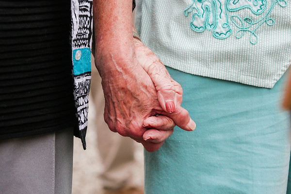 Violet Pelsor, left, and Jeanetta Jackson, future residents of Sprinville Manor in Charlestown, hold hands during an interview.