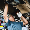 Owner of Grider's Automotive, Sam Grider, changes a pickup truck's oil on Friday. Staff Photos By Josh Hicks