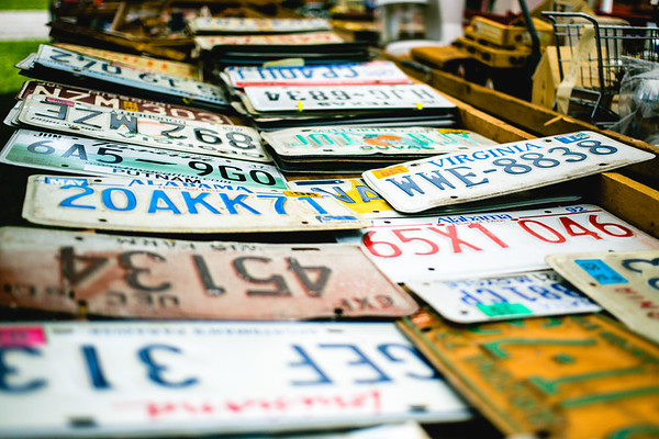 License plates from around the United States lay in a box waiting to be sold in Pekin on Saturday. The plates can be seen as a unique symbol of nation's state's unity.