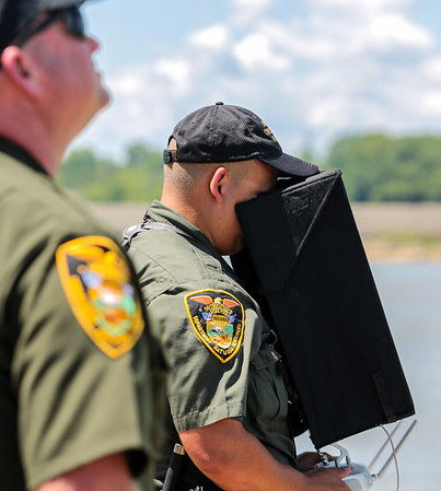 An Indiana Conservation Officer pilots a drone over the Ohio River.