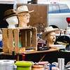 Mannequin heads flaunt hats and well groomed facial hair at a booth in Pekin on Saturday.