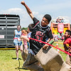 Javon Stewart, 12, hops across the potato sack race finish line during Jeff Fest at Big 4 Station on Saturday. Staff Photo By Josh Hicks
