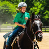 Morgan Froehle, 10, rides in on her horse after completing her first ever event at the Floyd County Fair on Saturday. Froehle has been riding for two months. Staff Photo By Josh Hicks