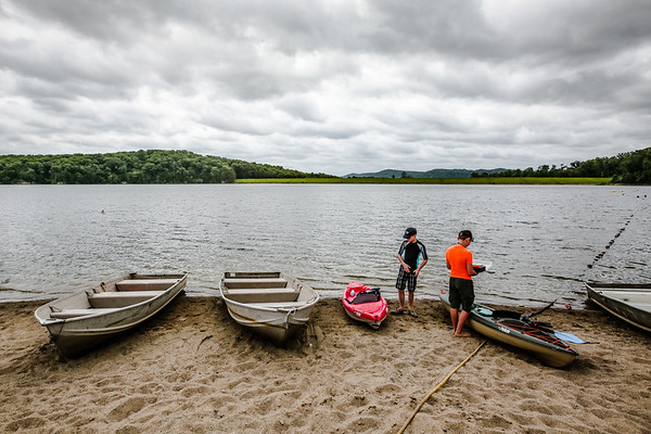 Seth Young, 13, and Kenton Pelsor, 13, prepare their kayaks for a fishing excursion on the shore of Deam Lake's on Thursday. Staff Photos By Josh Hicks