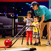 From left, Savannah, 3, Hunter, 1, and their mother Amber Cox bowl a frame together at Strike and Spare Family Fun Center in Clarksville on Friday. Staff Photo By Josh Hicks