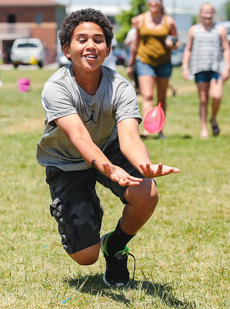 Russell Lassiter, 10, makes a diving catch during the water balloon toss during Jeff Fest at Big 4 Station on Saturday. Staff Photo By Josh Hicks
