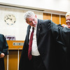 Patrice Branstetter, right, helps her husband Jeffery, center, put on his robe after being sworn in as the newest Magistrate by Judge Joseph Weber, left, in the Clark County Circuit Court three. Staff Photos By Josh Hicks