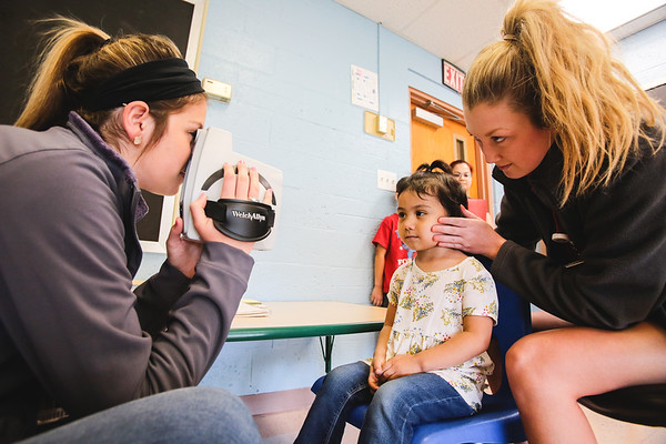 Scarlett Urquidi, 3, gets her eyes tested during the Head Start program at Community Action Southern Indiana on Wednesday. Staff Photo By Josh Hicks