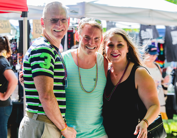 From left, Daniel Hutchins, Travis Rountree, and Ashley Ludewig came up from Louisville for the Jeffersonville Pride Festival on Saturday. Staff Photo By Josh Hicks